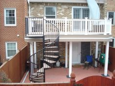 traditional deck with spiral staircase