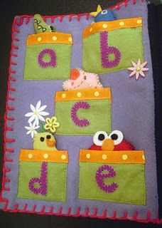 ABC book...a felt figure that starts with the letter in each pocket. Adorable! quiet book!!!!
