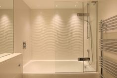 Waterspring LED lights from John Cullen triple the impact of these beautiful wavy tiles