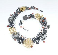 Suzan Rezac. Necklace: oxidized silver, 18K gold, 24K gold leaf, coral