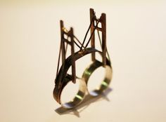 Dont know if I would wear this....but it is pretty neat.357 Suspension Bridge Ring