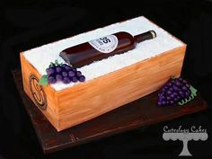 I made this cake for a wedding anniversary. The cake has fondant panels with a hand-drawn logo. The wine bottle is made from sugar, and the label is edible as well. White chocolate shred surround the bottle. Cakes That Look Like Food, Wine Bottle Cake, 50th Anniversary Cakes, Wooden Wine Boxes, Wine Sale, Cake Central, Cookie Pie, Unique Cakes, Box Cake