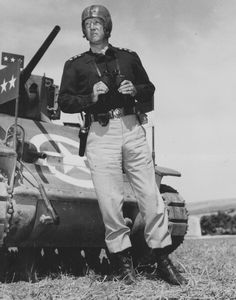 American military commander Lieutenant General George S. Patton (1885 - 1945) holds binoculars as he stands next to a tank during training maneuvers, 1940s. (Photo by PhotoQuest/Getty Images)