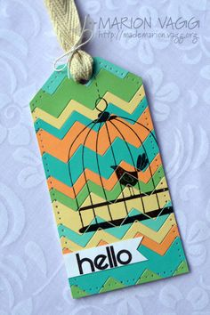 heat embossed birdcage over top of the chevron die tag