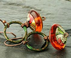 copper with green patina and lampwork orange beads