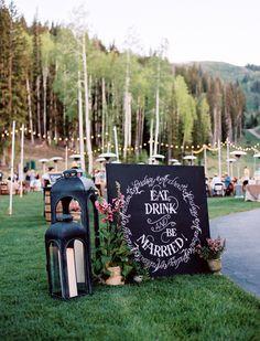 lanterns + chalkboard sign + strings of outdoor lights