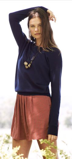 Sweater over dress with necklace