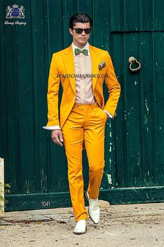 Gold short-tailed suit in 'Alta Moda Solbiati' cotton satin fabric, with peak lapel, single corozo button closure and single vent at back, style 1041 Ottavio Nuccio Gala, 2015 Fashion Collection.