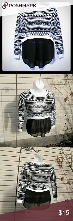 Chiffon Peplum Sweater Adorable Hi-Low Black & white soft sweater with flowy black chiffon bottom. Perfect paired with leggings!  Measured flat 20'' across bust 26'' long front 29'' long back 16'' sweater length On 36'' x 31'' x 36'' mani Dolled Up Tops