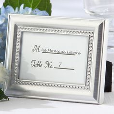 Give your guests a gracious welcome with these elegant little place card frames. As low as $1.30/each #wedding #reception