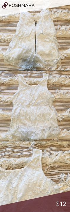 Lace tank top 🐸 White ruffles & lace tank top with a zipper front.   In really great condition other than a small red stain o the top back left shoulder (check pictures). silence + noise Tops Tank Tops