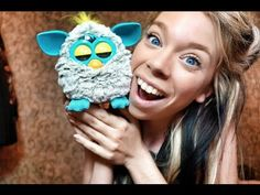 This girl is so obnoxious, but so is the Furby, so it kind of works. I think I might reset my Furby from the 90s and see what happens.