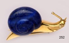 Retro Carved lapis lazuli and gold snail brooch. Herm鋊, Paris.
