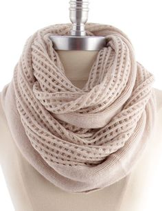 """A soft & cozy taupe/oatmeal tone infinity scarf that features a grid pattern.  60"""" Circumference, 22"""" Width100% Acrylic  restocking mid jan"""