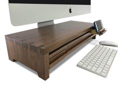 The world's most functional and beautiful computer stands made from sustainable urban Walnut wood. Six drawers, old-world dovetail construction, iMac undermount, cable management, two secret drawers. Computer Humor, Computer Help, Computer Tips, Gold Apple Watch, Monitor Stand, Cable Management, Desktop Computers, Dell Computers, Home Office Furniture