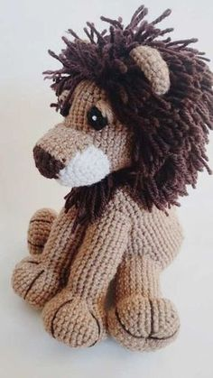 Crochet Stuff Bears free pattern for a lion amigurumi on this site - Hello crochet lion, Rawr! I'm made this little guy for my adorable little nephew. Not sure if he'd appreciate a plush toy, but I know for sure that if he had a spirit animal lion would … Crochet Lion, Crochet Amigurumi Free Patterns, Crochet Animals, Crochet Dolls, Crochet Baby, Free Crochet, Knit Crochet, Crochet Stitches, Baby Knitting