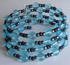 Aqua Blue Bubbles with Hematite and Black Glass Beads on Four Loops of Oval Memory Wire Bracelet by VineDesignBeads
