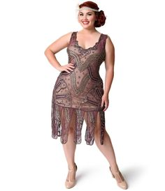 """Unique Vintage Plus Size 1920s Style Purple & Gold Beaded Sinclair Flapper Dress. ImportedProfessional Spot CleanPulloverSemi-Sheer Hand Beaded MeshMaterial Has Some StretchSlip Not IncludedModel Pictured Wearing Size 2XModel Info: Height: 5'6"""" 