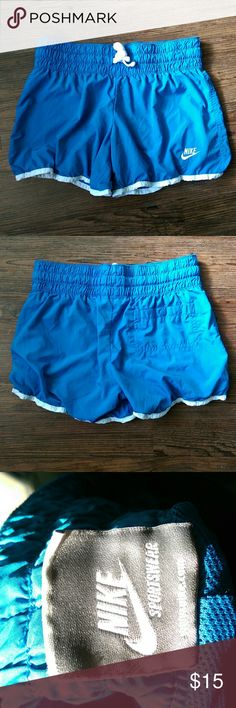 Nike Athletic Shorts Blue Nike Athletic shorts in great condition. These have mesh lining making the shorts very breathable and great to work out in.   Size: XS (0-2) 100% polyester Nike Shorts
