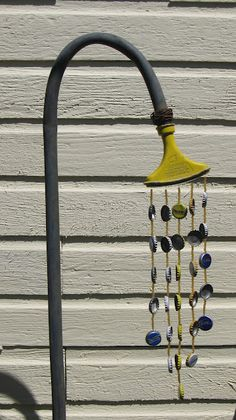 Garden Wind Chimes:  a hose (actually a pipe) and water nozzle and bottle caps