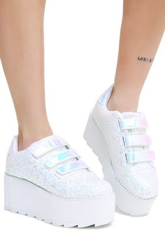 Y.R.U. Icy Lala Platform Sneakers are perfectly dream worthy. These pretty glittery platform sneakers have a lightweight Eva platform, textured tread and velcro closures.