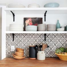 kitchen counter with tiles, art, and bowls