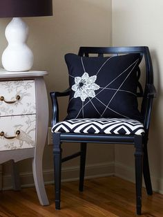 Turn a basic black pillow into a spooky spiderweb with embroidery floss. More easy Halloween crafts: http://www.bhg.com/halloween/outdoor-decorations/spooky-home-decorations/?socsrc=bhgpin103012spiderwebpillow