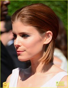 Kate Mara brightens up the red carpet in a yellow dress while attending the 2014 Creative Arts Emmy Awards on Saturday (August 16) at the Nokia Theatre L.A. Live.