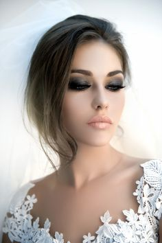 Dark smokey eye with a coralish lip. Great look for brunettes
