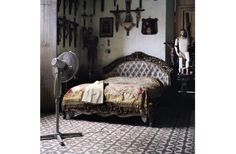 This one we have in the living room! :)  Olga Chagaoutinova | A fan, a bed and crosses. Cuban Pictures | C-Print | 2007