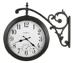 <p> This attractive double sided wall clock is designed for indoor or overhang outdoor use in moderate temperatures. A thermometer located above the six position indicates the temperature in degrees F. The antique iron-finished, powder-coated case is zinc plated and includes stainless steel screws to inhibit rusting. The dial, which is off-white with black hour and minute ...