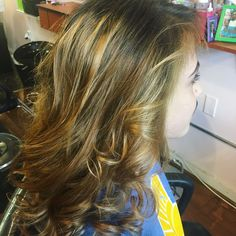 Subtle blonde and caramel ombre highlights at Get Gorgeous Salon  in St. Paul MN