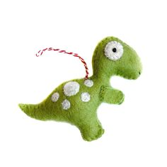 Travel back in time with this crew of whimsical dinosaur Christmas ornaments from Ornaments 4 Orphans. This pack of prehistoric pals includes a T-Rex, Brachiosaurus, Stegosaurus, Spinosaurus, and Pteranodon ornament. So for a touch of fun to your tree this year, make sure you treat the kids to these colorful felted Christmas ornaments. Product Details Handmade in Nepal Every purchase empowers global artisans and enriches the lives of vulnerable children. Ornaments 4 Orphans give back to non-prof