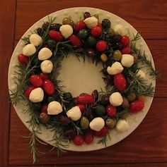 Rosemary wreath with olives, cherry tomatoes and mozzarella balls. Maybe add some fresh basil leaves for caprese + olives.