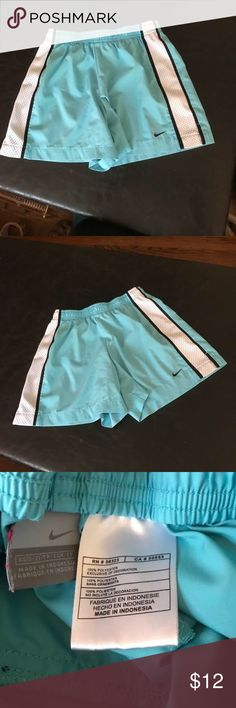 Nike light blue & white black running shorts XS Nike light blue & white black running shorts XS (0-2) in great condition no signs of ware! make an offer or bundle & save Nike Shorts