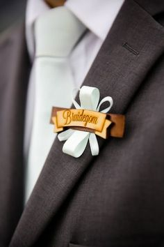 Vintage Boutonnieres: The bridegroom and the rest of the men in the bridal party wore wooden boutonnieres with a mint ribbon.. Vintage Peach and Mint Wedding, Wellington ♥  ♥  ♥  LIKE US ON FB: www.facebook.com/confettidaydreams  ♥  ♥  ♥
