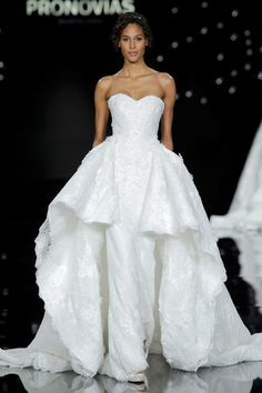 Overlaid with lace and adorned with tiny 3D flowers, this Pronovias gown is the height of bridal luxury.