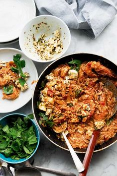 Yotam Ottolenghi's easy recipe for Orzo with Prawns, Tomato and Marinated Feta is the ideal quick weeknight pasta supper, made with simple ingredients that come together to create a mouthwatering summer dish. Yotam Ottolenghi, Ottolenghi Recipes, Giada De Laurentiis, Orzo Recipes, Cooking Recipes, Simple Prawn Recipes, Cooking Time, Seafood Recipes, Delicious Recipes