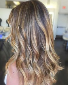 Root-to-tip gold and espresso balayage.