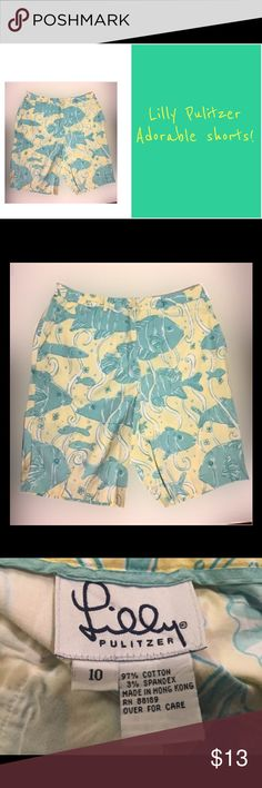 "Lilly Pulitzer size 10 fishy shorts Size 10 shorts. Yellow/green color. 97% cotton, 3% spandex. Length 18"". Gently used. Lilly Pulitzer Shorts"