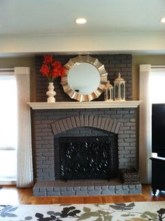 Painted fireplace - not white! It looks good.