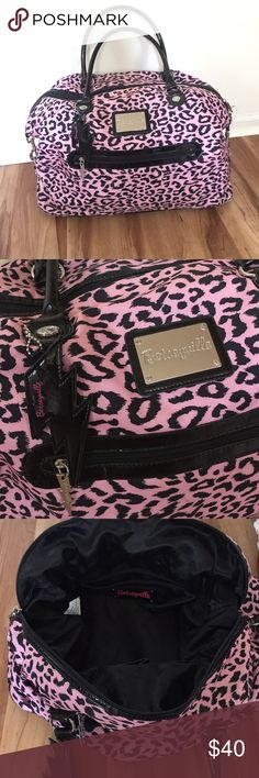 Large Betsey Johnson travel bag BetseyVille Adorable Betsy Ville by Betsey Johnson large travel bag. This is in great condition with a tiny bit of where on where the handles meet the bag. One of the pictures shows that otherwise this bag is very clean and in great condition. The body is 100% nylon, the trim is 100% PVC and the lining is polyester. The handle drop is about 11 inches. Bag opens up to about 23 inches. It is about 14 inches deep. It's very large and hold a lot. There is a little…