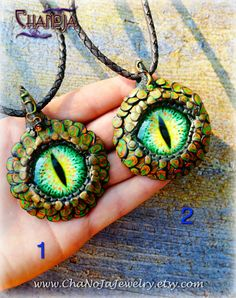 Dragon Eye Pendant Pair-orange green by ChaNoJaJewelry. More pieces of our popular series of ChaNoJa's corporate identity - this time in beautiful orange and green tones! This breathtaking creation is designed and created by Norbert, the No-part of ChaNoJa, and the finishing touches are done by Chan. We are a great team :) A truly extraordinary piece of wearable art. Can be worn by both men and women and any fantasy and dragon lover!