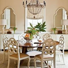 Sea Island Dining Room | A large round table in a square dining room makes conversations easier and most have leaves for extra seating.