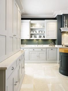 This sleek painted kitchen is a contemporary twist on a traditional shaker style featuring bespoke cabinetry and dark oak kitchen dresser. Kitchen Cupboard Colours, Kitchen Pantry Cupboard, Kitchen Dresser, Kitchen Units, Kitchen Cupboards, Modern Shaker Kitchen, Timber Kitchen, Kitchen Flooring, Kitchens And Bedrooms