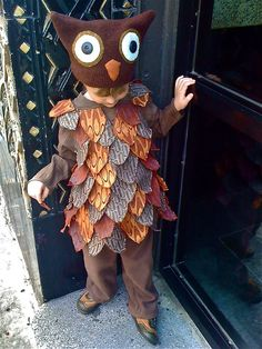"My preschooler insisted for weeks that he only wanted to be himself for Halloween, so when he decided an owl costume might be acceptable, I ran with it. The hat is constructed from a felted sweater, with felt eyes and pupil buttons purchased at the flea market in Woodstock, NY. The bodice is an Old Navy tunic covered in ""feathers"" made from upholstery remnants. The pants are fleece. And the boy is mine."