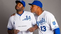Surprise, AZ, USA; Kansas City Royals outfielder Lorenzo Cain (left) poses for a portrait as catcher Salvador Perez jokingly attempts to kiss him. -  © Mark J. Rebilas-USA TODAY Sports Feb 27, 2015