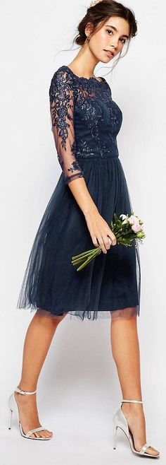 (Lovely dress, with a beautiful little posy-bouquet. Very nice combo :) Midnight blue sparkle dress with flare skirt by Chi Chi London
