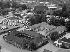The car park to the north and east of the school would, in a few years, become the site of the Dolphin Centre, whilst the site of the school would later be occupied by the Liberty 2 shopping centre.    Looking at the rest of the view, beyond the car park is Romford Baptist church, and opposite that, on the far side of Main Road, is Coronation Gardens, with the war memorial standing in the centre.  http://www.romford.org/schools/st-edwards/st-edwards18.htm