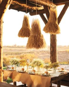 Wheat Chandelier - Martha Stewart Weddings Planning & Tools  |  Wheat Chandelier Indoors or out, a glowing tablescape like this one pulls all the rustic pieces together. It looks polished, but it's actually quite resourceful: The harvest-theme chandeliers are wheat-covered wire baskets, and the vases holding clouds of pretty wildflowers are recycled metal cans spray-painted a glossy white. For an instant, on-point tablecloth, lay out a length of raw-edged leather. Click here for the how to's